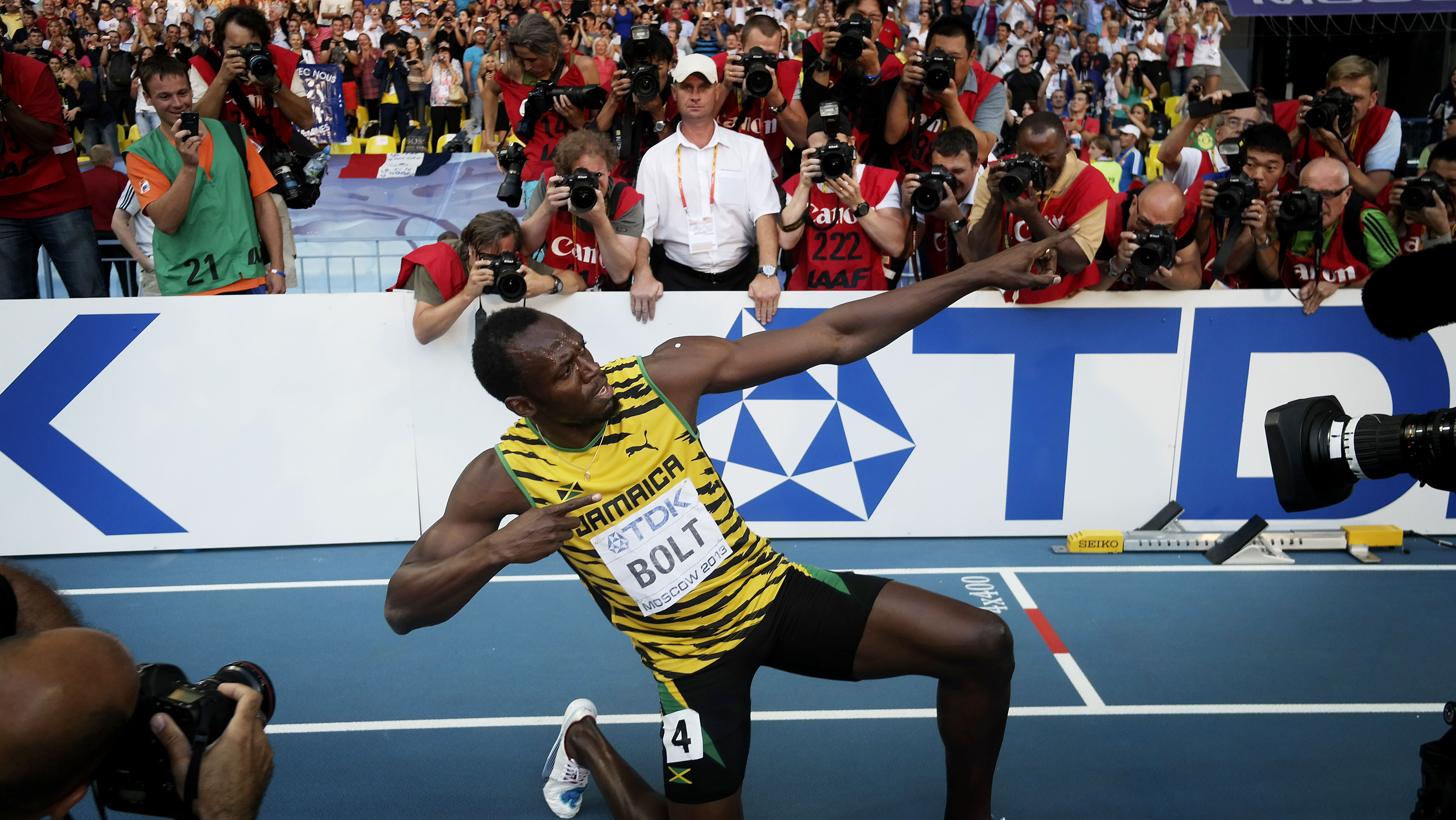 Usain adds the 200m title