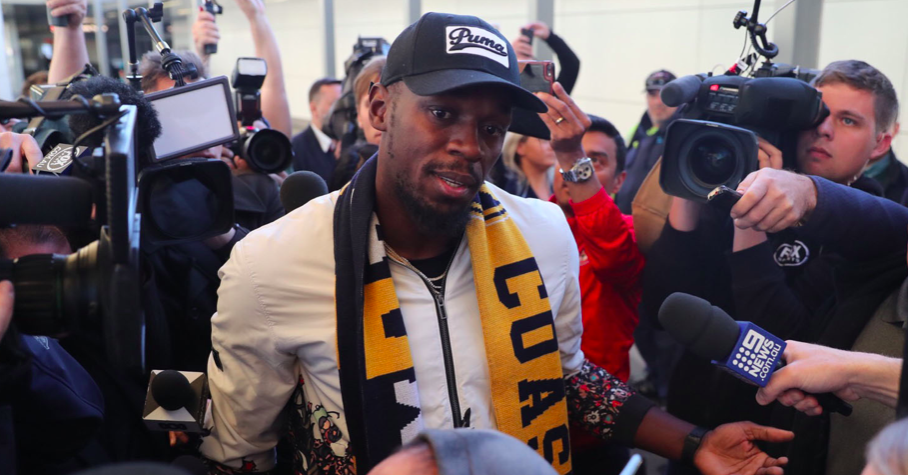 Usain arrives in Australia to start football career