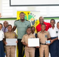 Usain Bolt Foundation refurbishes school ground and hands over computer equipment to schools in Trelawny